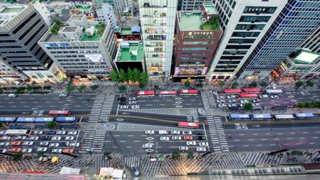 View of traffic moving on Gangdamdaero Street near Gangnam Station at night