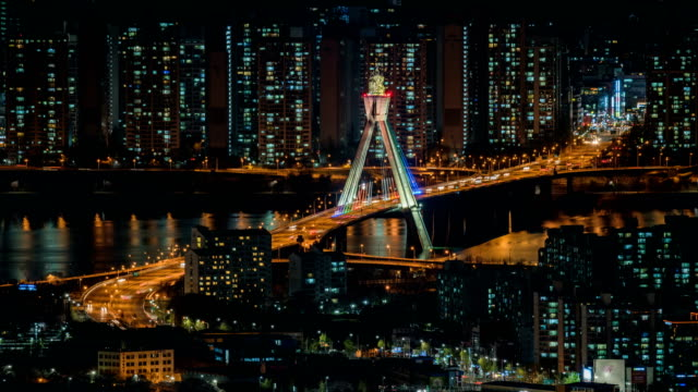 View of traffic moving on Ollimpikdaegyo bridge at night