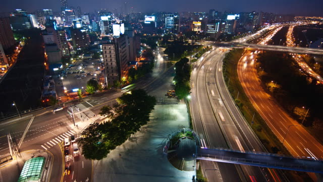 WS HA T/L View of Traffic moving on Ollimpikdaero road at Singil area at night / Seoul, South Korea
