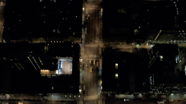 ms aerial tu view of traffic moving on road through cityscape near battery park at lower east side of manhattan / new york, united states - city street stock videos & royalty-free footage