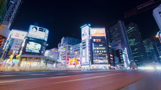 WS T/L LA View of traffic on city street at night / Shinjuku, Tokyo, Japan