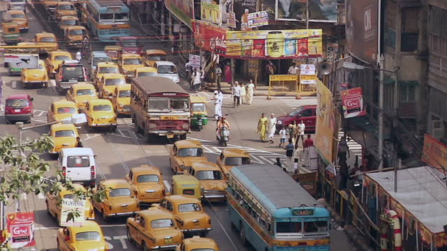 ws view of traffic on city street  / kolkata, west bengal, india - kolkata stock videos & royalty-free footage
