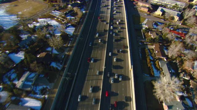 ws pov aerial view of traffic on i-25 in denver suburbs / denver, colorado, usa  - denver stock videos & royalty-free footage