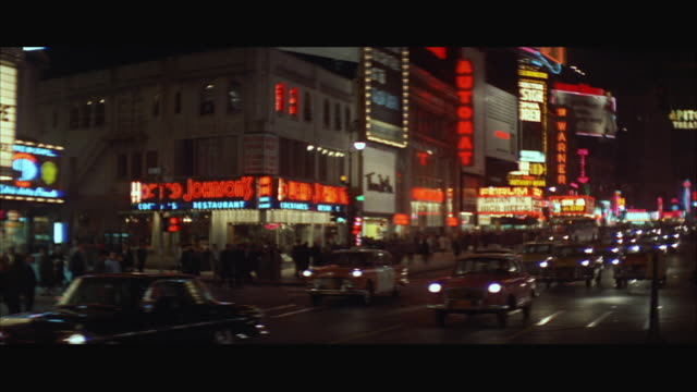 stockvideo's en b-roll-footage met ws pan view of traffic on new york city street / new york city, new york, usa - 1963