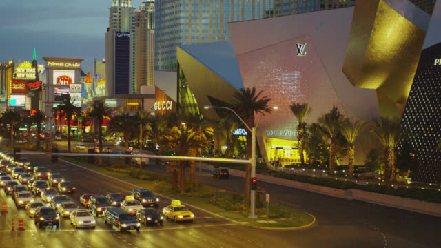 WS View of traffic on raod at night WS View of mall and building / Las Vegas, Nevada, United States
