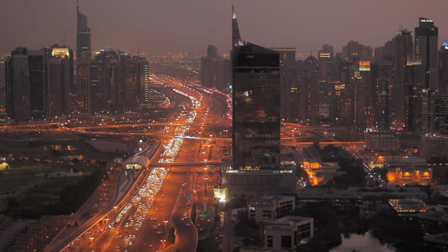 WS View of traffic on Sheikh Zayed Road and Marina at night / Dubai, United Arab Emirates