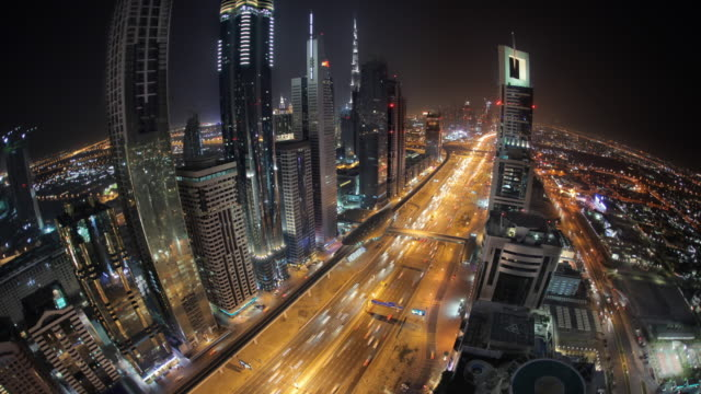 WS T/L AERIAL View of traffic on Sheikh Zayed Road at night / Dubai, United Arab Emirates