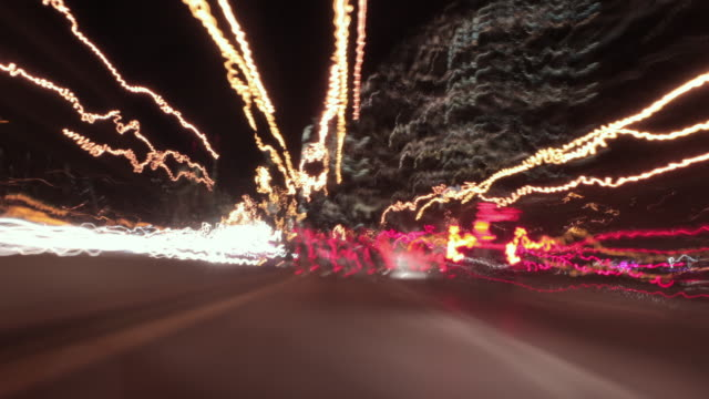 vídeos y material grabado en eventos de stock de ws pov t/l long exposure view of traffic on street at night in  harlem / manhattan, new york, usa - light trail
