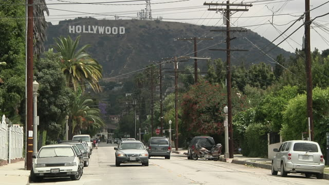 vidéos et rushes de ws view of traffic on street / los angeles, california, usa - hollywood boulevard