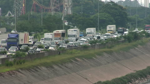 ws view of traffic on street / sao paulo, brazil - commercial land vehicle stock videos & royalty-free footage