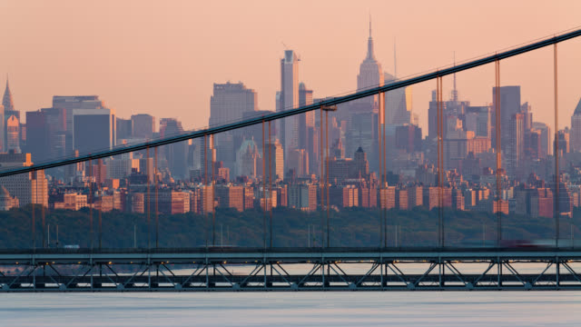 T/L View of traffic on the George Washington Bridge with the Manhattan skyline in the background at sunset