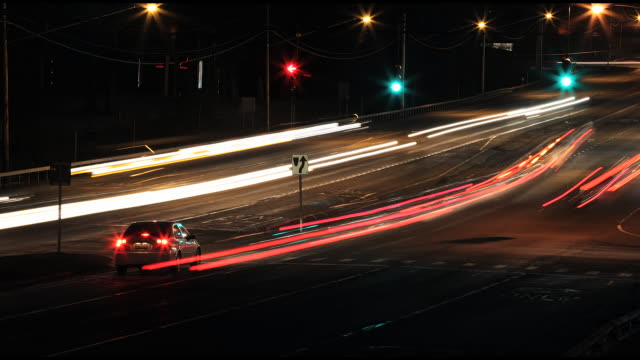 WS TL View of Traffic passing intersection at night / Vestal, New York, United States