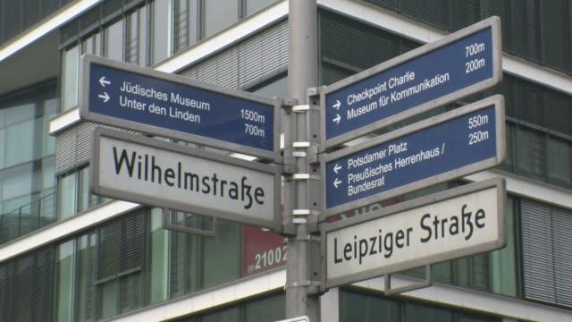 stockvideo's en b-roll-footage met  cu view of traffic sign at wilhelmstrasse / berlin, germany - straatnaambord