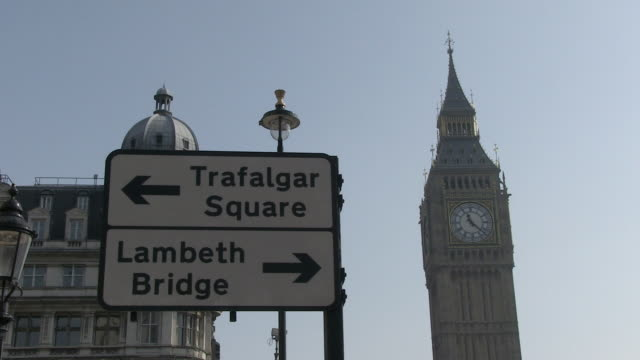 ms view of traffic sign behind big ben tower / london, england, great britain  - road sign stock videos & royalty-free footage
