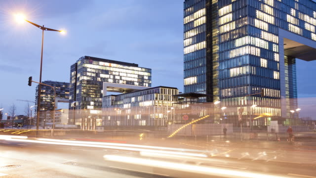 WS T/L View of Traffic with office buildings at dusk / Cologne, North Rhine-Westphalia, Germany