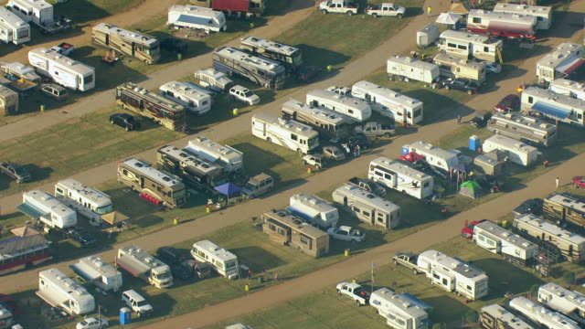 ms aerial zi zo view of trailers and people tailgating at talladega superspeedway / lincoln, alabama, united states - camper van stock videos and b-roll footage