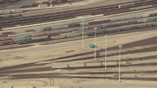 ms aerial zo view of train car moving on track at bnsf argentine hump yard / kansas, united states - 操車場点の映像素材/bロール