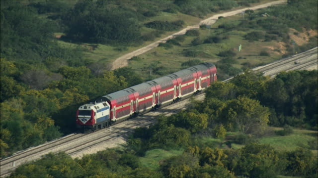 vídeos de stock, filmes e b-roll de ws ts aerial view of train in plain / sharon, israel - israel