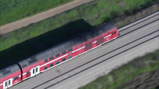vídeos de stock, filmes e b-roll de ws ts zi zo aerial view of train in sharon plain / sharon, israel - israel