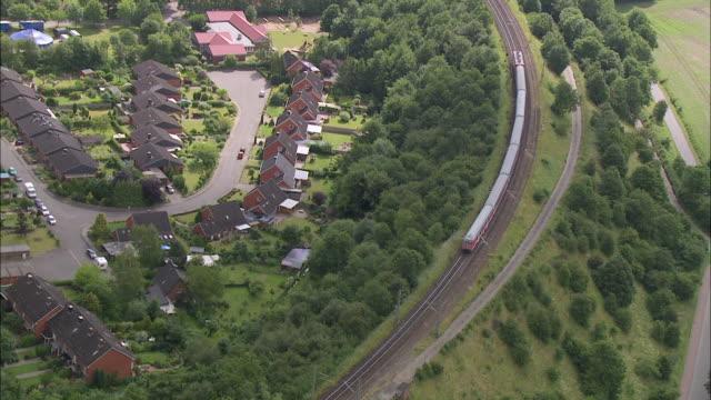 aerial ws pov view of train moving on bridge / kiel canal, schleswig-holstein, germany - schleswig holstein stock-videos und b-roll-filmmaterial