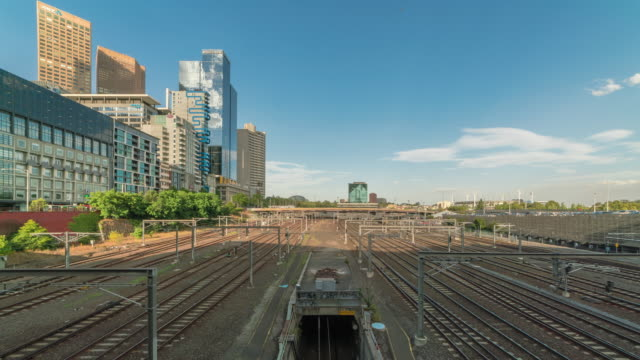 view of train moving on railroad of melbourne station - train vehicle stock videos & royalty-free footage