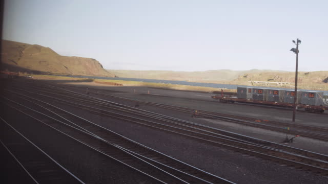 View of train yard from window of passenger train
