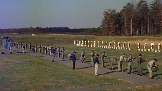 WS View of  trainees and instructors on rifle range / Washington D.C. , United States