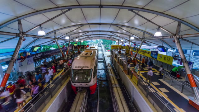 ms t/l view of trains arriving and departing from kl monorail station / kuala lumpur, malaysia - monorail stock videos and b-roll footage