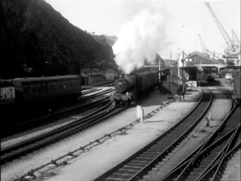 ms view of trains running on tracks and ship coming into harbor / fishguard harbour, pembrokeshire, wales - steam train stock videos & royalty-free footage