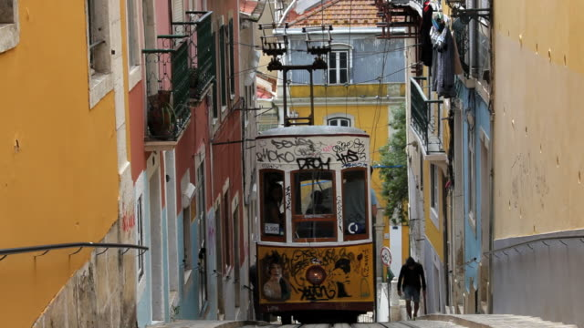 View of tram moving on narrow gauge rails within the city, Lisbon, Portugal, Europe