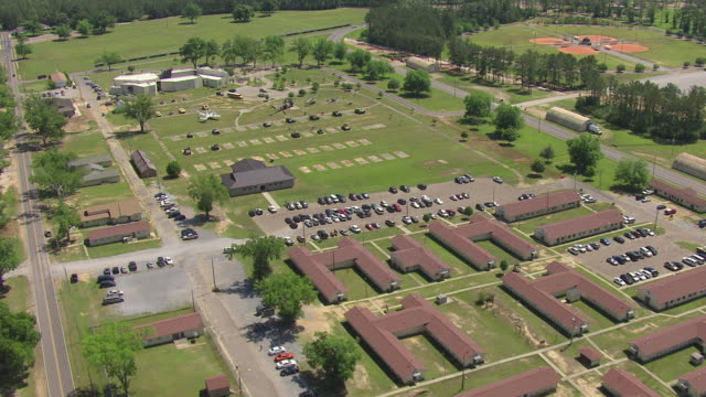 ws aerial td view of traveling over barracks and campus at military post camp shelby / mississippi, united states - military camp stock videos & royalty-free footage