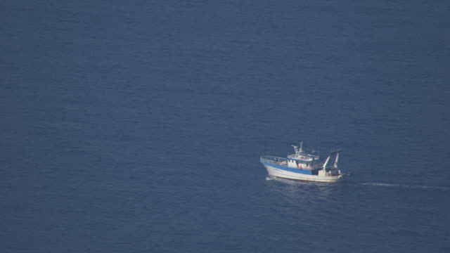 WS AERIAL View of Trawler moving in sea / Zakynthos, Ionian Islands, Greece