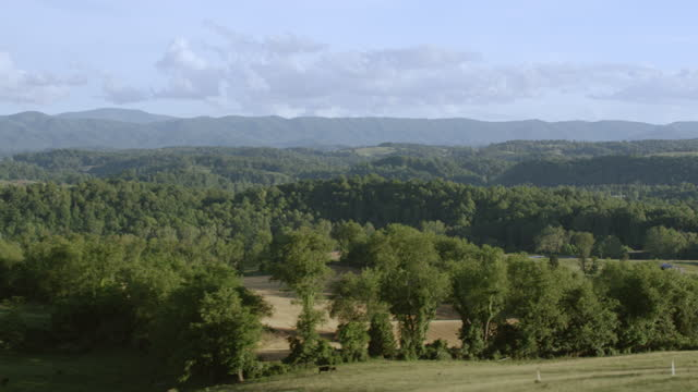 WS AERIAL POV View of tree area with mountains in background / Smyth County, Virginia, United States