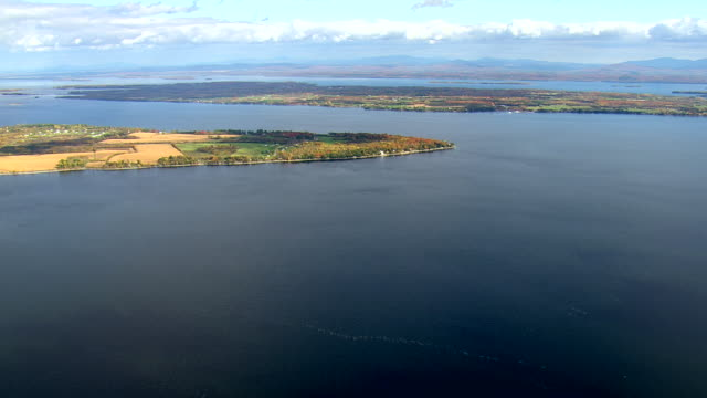 ws aerial pan zi view of tree covered island in bay at plattsburgh / new york, united states - plattsburgh stock videos and b-roll footage