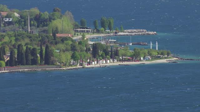 WS View of trees and lake / Lake Garda, Trentino, Verona, Brescia
