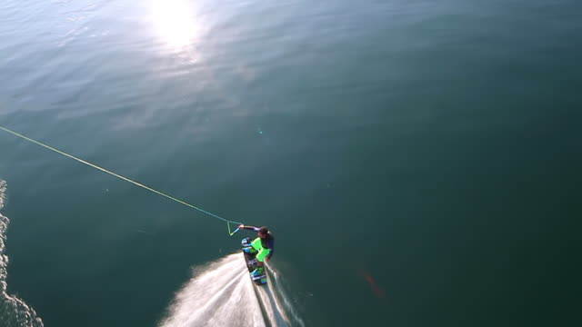 WS AERIAL SLO MO TS View of trick of wakeboarder in geneva / geneva, switzerland