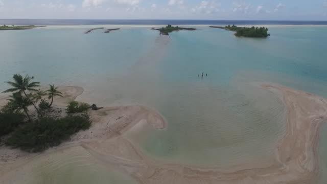 stockvideo's en b-roll-footage met aerial view of tropical lagoon and islands - franse overzeese gebieden