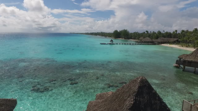 stockvideo's en b-roll-footage met aerial view of tropical lagoon and overwater bungalows - frans polynesië