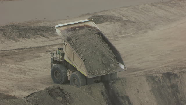 WS AERIAL TS View of Truck dumping dirt in pile at North Antelope Rochelle Mine / Wyoming, United States