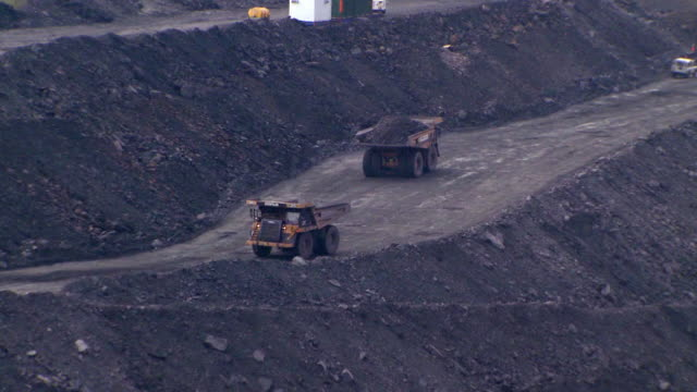 ms view of trucks passing each other in opencast mine / ffos-y-fran / merthyr tydfil, glamorgan/wales, united kingdom - open cast mine stock videos & royalty-free footage