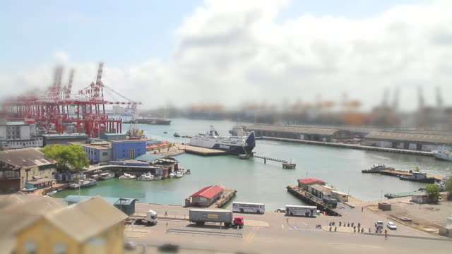 WS T/L View of trucks, ships and tugs zip around Colombo Port / Colombo, Western Province, Sri Lanka