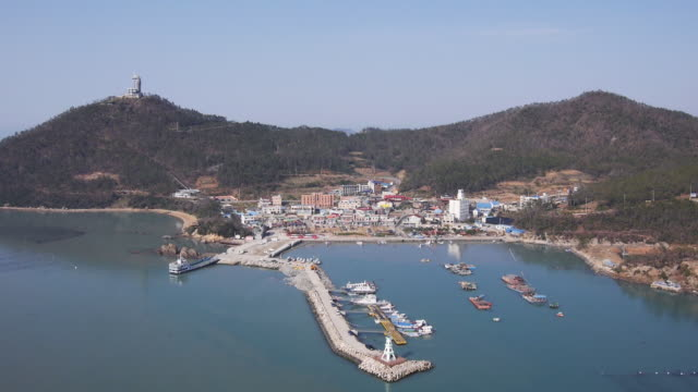 view of ttangkkeunmaeul fishing village and seascape in the morning - 1 minute or greater stock videos & royalty-free footage