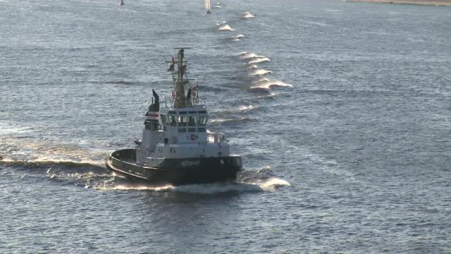 MS View of tug boat at river elbe / Hamburg, Germany