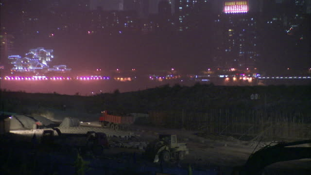 ws zo view of tunnel project and city at night / chongqing, sichuan province, china  - 建設機械点の映像素材/bロール