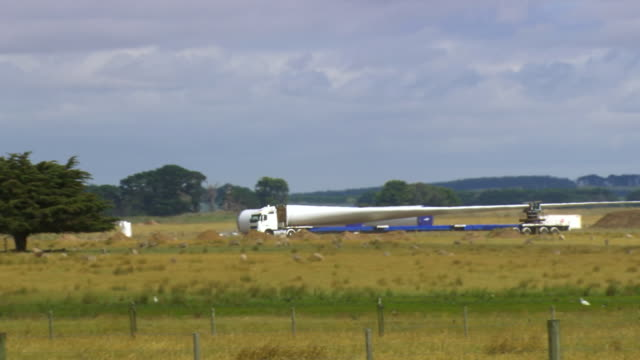 ws ts view of turbine blade arriving on truck / macarthur, victoria, australia - blade stock videos & royalty-free footage