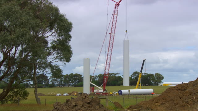 ws view of turbine column into position / macarthur, victoria, australia - pole stock videos & royalty-free footage