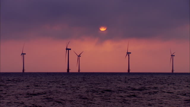 ws view of turbines in sea / great yarmouth, norfolk,  united kingdom - norfolk england stock videos & royalty-free footage