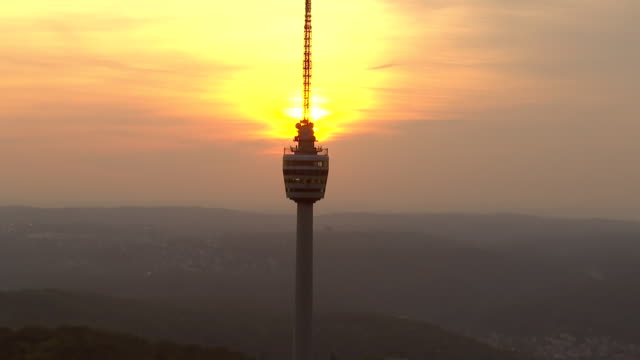 ws aerial zi view of tv tower and city at sunset / stuttgart, baden wurttemberg - antenne stock-videos und b-roll-filmmaterial
