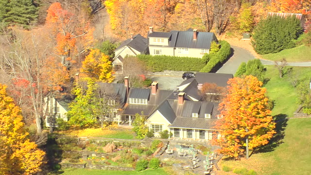 MS AERIAL ZI PAN View of Twin Farms Resort surrounded by wooded area with autumn color / Vermont, United States