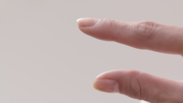view of two fingers splaying and closing - menschlicher finger stock-videos und b-roll-filmmaterial